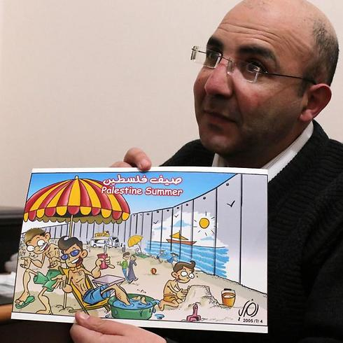 Ramzy Taweel shows one of his drawing in the West Bank city of Ramallah (Photo: AFP)