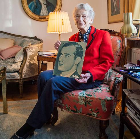 Nina Lagergren holds a picture of her brother at her apartment in Djursholm near Stockholm (Photo: AFP)