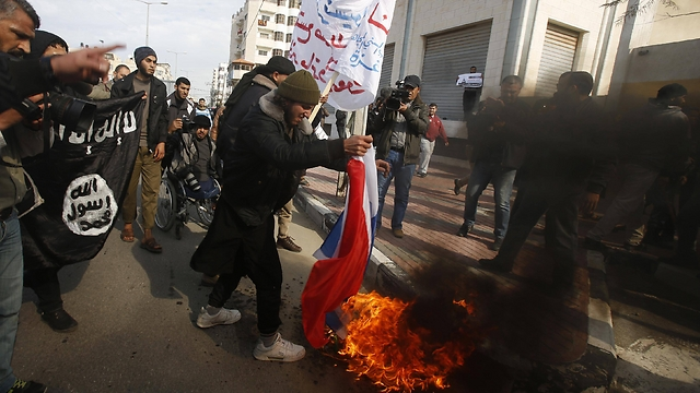 French flag burned and Islamic State flag wave during Gaza rally.(Photo: Reuters)