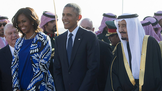 Michelle and Barack Obama with Saudi King Salman on a visit to Saudi Arabia (Photo: AFP)