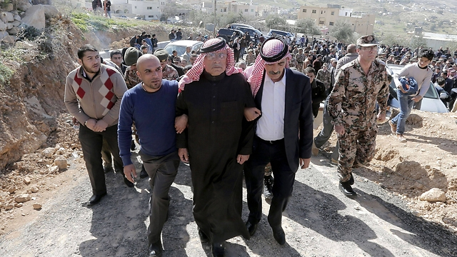 Jordanian pilot's father at funeral in Jordan. (Photo: AFP)