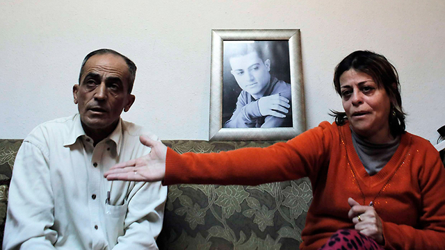 Muhammad Musallam's parents (Photo: Reuters)