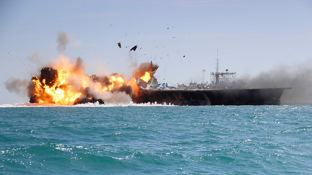 Iran blowing up a replica US warship during a military drill. 'Obama doesn't get it.' (Photo: AP)