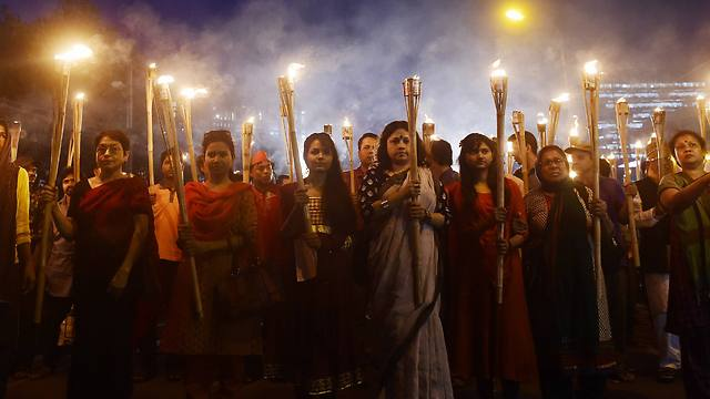 Bangladeshi secular activists take part in a torch-lit protest against the killing (Photo: AFP)