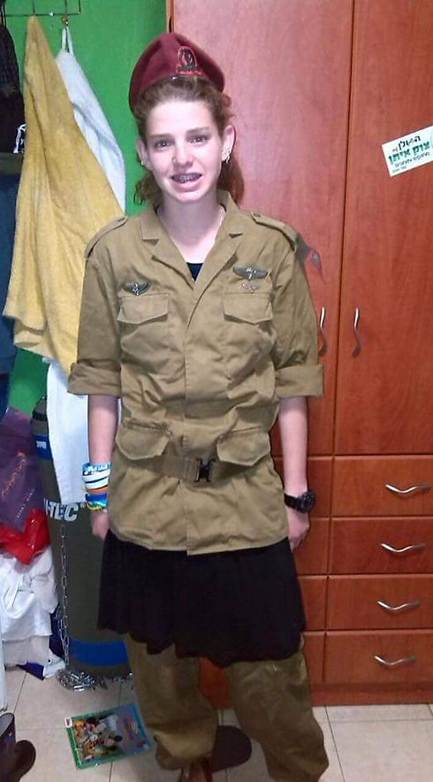 Miriam Shalev wearing Shahar's uniform (Photo courtesy of family)