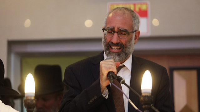 Gabriel Sassoon speaks at his childrens' funeral (Photo: Gil Yohanan)