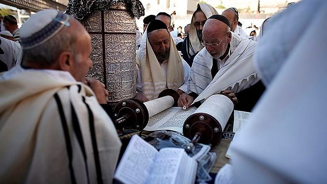 Reading from the Torah (Photo: AFP)