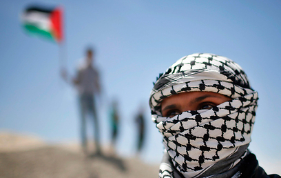 Palestinian wearing a keffiyeh on Nakba Day (Photo: Reuters)