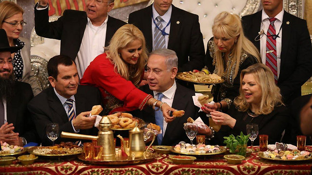 Prime Minister Netanyau and his wife Sara at Mimouna celebrations in Or Akiva (Photo: Elad Gershgoren)