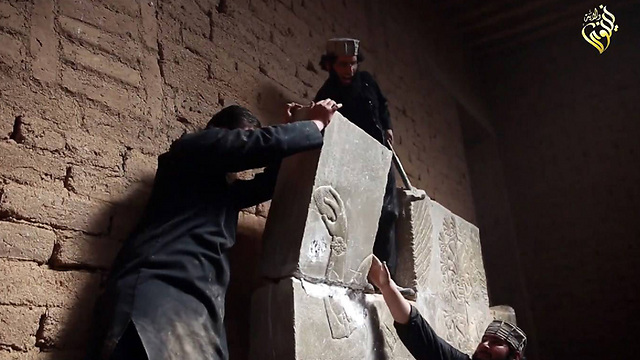 Militants destroying a relief (Photo: AFP)