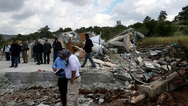 Residents of Kafr Kanna stand in the rubble of a demolished home (Photo: Hassan Shaalan)