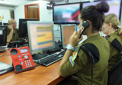 Troops at one of the IDF's situation rooms.
