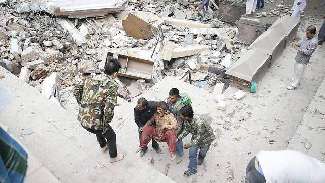 Injured being pulled out of the wreckage in Nepal (Photo: EPA)
