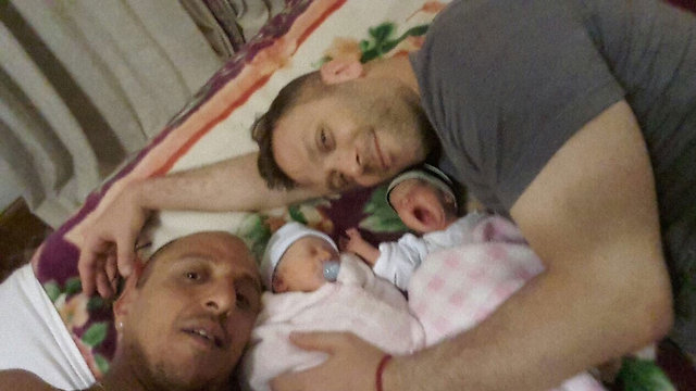 Ohad Hitman with his partner and newborns