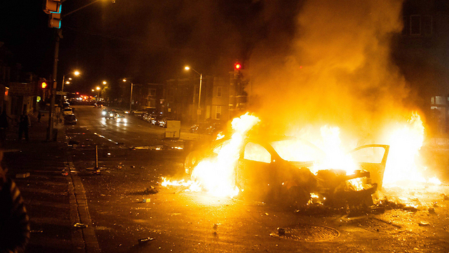 Burning car in Baltimore (Photo: EPA)