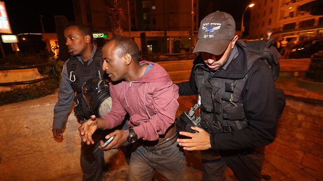 Ethiopian Israeli man arrested during protest. (Photo: Gil Yohanan)