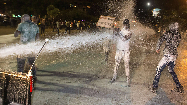 Police turn water cannons on protesters (Photo: AFP)
