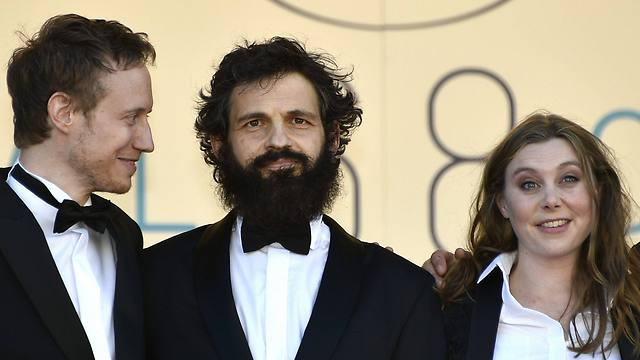 Director Laszlo Nemes, actor Geza Rohrig and screenwriter Clara Royer arrive for the screening Son of Saul during the 68th annual Cannes Film Festival (Photo: EPA)