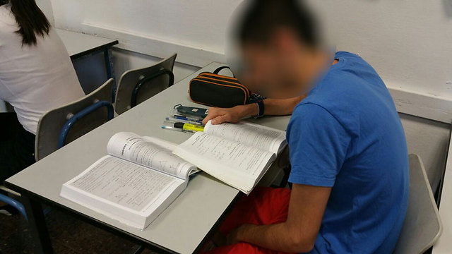 Student taking matriculation exam in math (Photo: George Ginsberg)