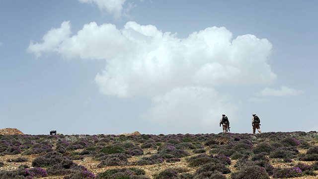 Journalists' tour of fighting zone in Qalamun Mountains. The goal was clear: To show the world how Hezbollah is fighting the 'radical and dark Islam' (Photo: AFP)