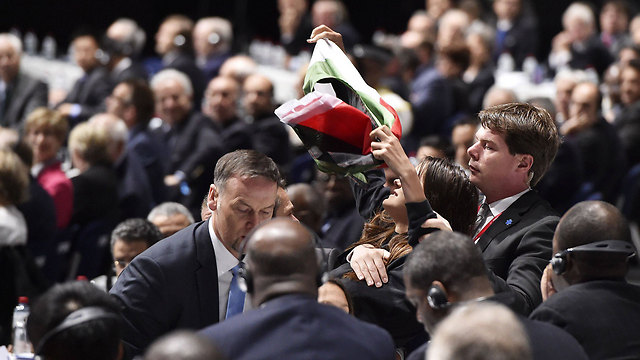 A pro-Palestinian protester interrupts Blatter's speech. (Photo: AFP)