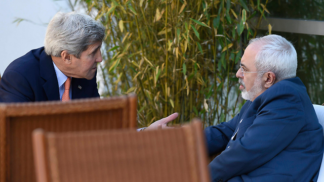 US Secretary of State John Kerry (L) with Iranian counterpart Mohammad Javad Zarif in Switzerland during the last round of talks (Photo: AP)