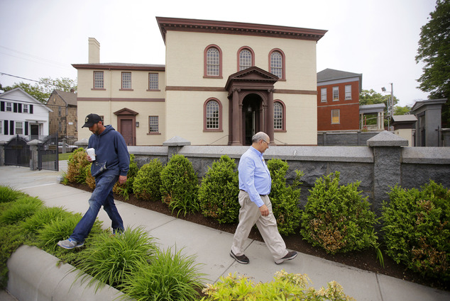 Employees walk through Patriots Park at the Touro Synagogue, the United States' oldest, in Newport, RI (Photo: AP)