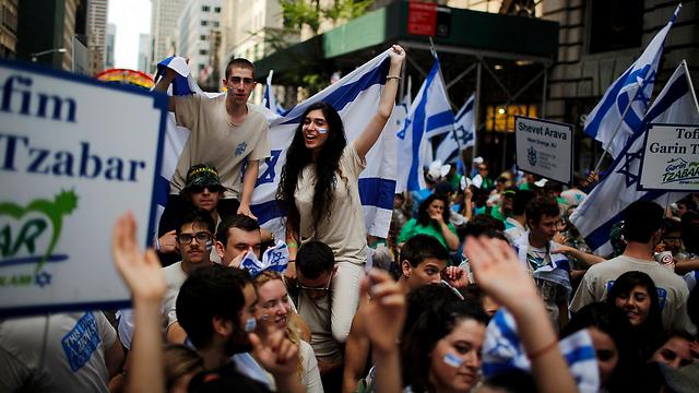 המצעד בניו יורק. חלק מהצעירים אמרו שיישארו בארץ גם אחרי הצבא (צילום: רויטרס)