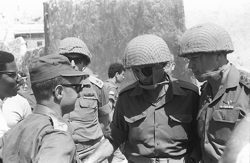 Then-IDF chief Rabin (right) with then-defense minister Dayan (second to the right), then-GOC Central Command Uzi Narkiss and then-chief of the Operations Directorate Rehavam Ze'evi in Jerusalem (Photo: IDF Archive)