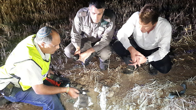 Sdot Negev officials inspect the remains of the rocket that struck Wednesday night. (Photo: Roi Idan)