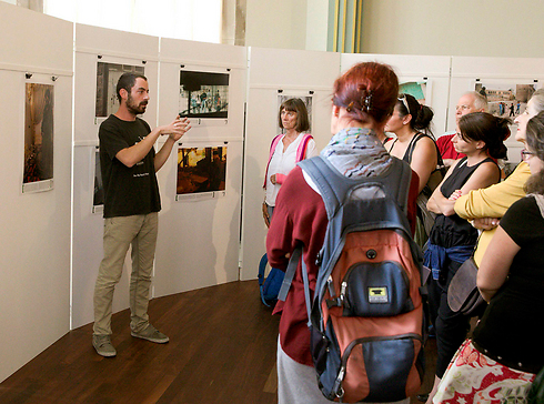 Breaking the Silence photo exhibition. Although they are lying, the organization's activist have no problem to operate freely in the State of Israel (Photo: Reuters)