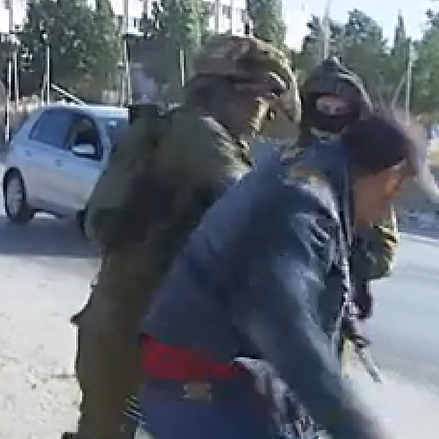 IDF to investigate video of IDF soldiers beating Palestinian