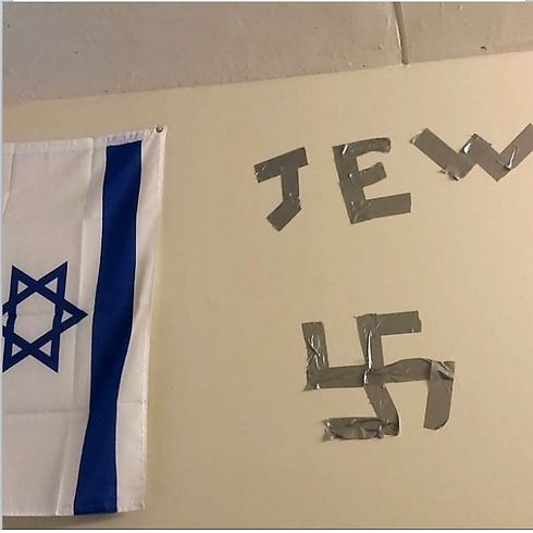 Swastika and the word 'Jew' taped next to student's Israeli flag in Drexel dorm room (Photo: ADL)