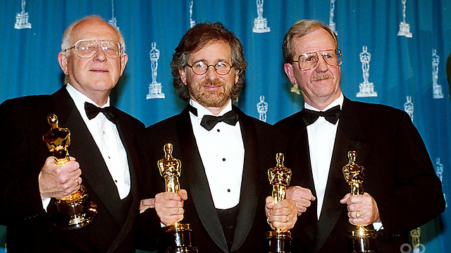 Lustig, left, with Spielberg, center, and the golden award (Photo: Courtesy of Yad Vashem)