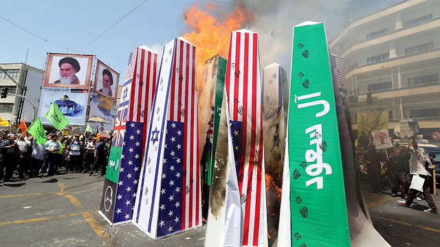 Anti-US and anti-Israel displays at al-Quds Day commemorations in Tehran (Photo: AFP)