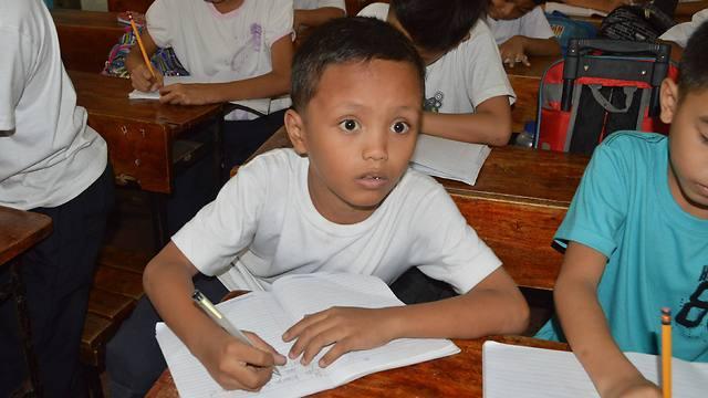 הפך לסמל של הילדים העניים בפיליפינים (צילום: AFP)