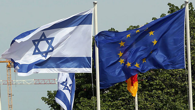 The Israeli and European Union flags in Berlin (Photo: AFP)