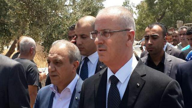 Faraj, left, with Palestinian PM Rami Hamdallah (Photo: Elior Levy)