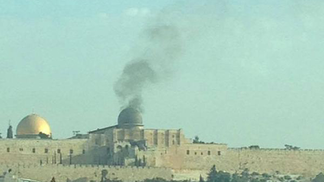 Smoke billows above the Temple Mount