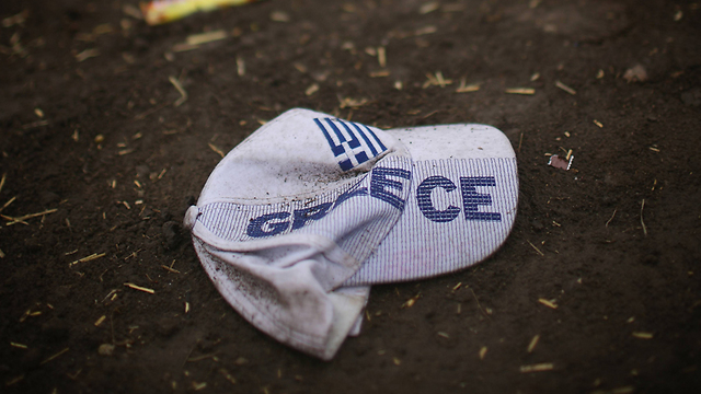 A baseball cap with Greek writing. Many refugees pass through Greece on their way to the northwestern parts of Europe. (Photo: Getty Images)