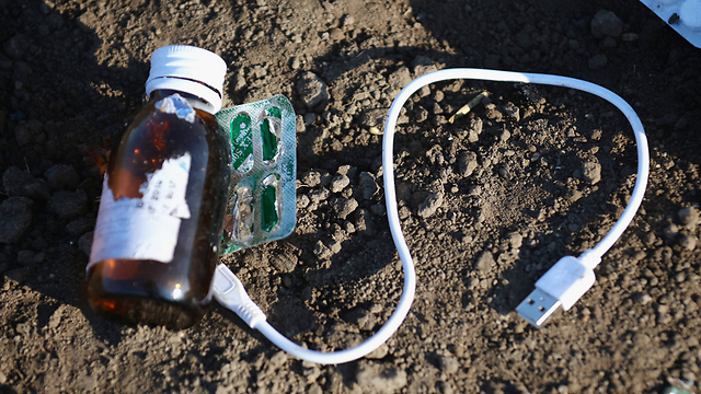 A USB cable and some medicine. Even when wandering, refugees try to charge their phones and stay connected as much as possible. (Photo: Getty Images)