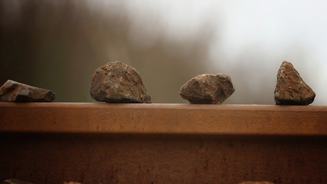 Rocks left on the train tracks, perhaps as a game, perhaps out of boredom. (Photo: Getty Images)