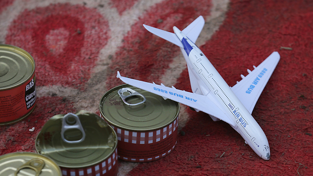 A toy plane and canned goods. (Photo: Getty Images)
