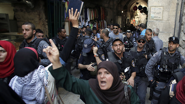 Palestinians and Israeli security forces this month (Photo: AFP)