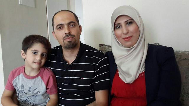 ג'ואברה ומשפחתה. צריך למחות נגד רצח (צילום: מוחמד שינאווי)