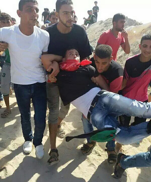 A Palestinian in Gaza, hit by IDF fire.