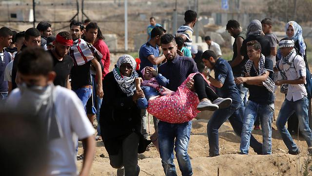 עימותים בגבול עזה (צילום: AFP)