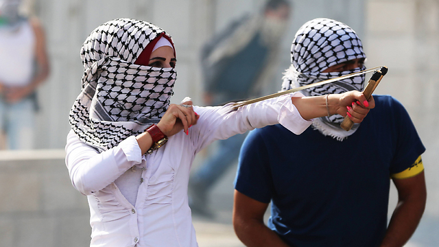 Palestinians using slingshot in Bethlehem. (Photo: MCT)