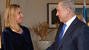 Mogherini and Netanyahu meet in Berlin Photo: Amos Ben Gershom, GPO