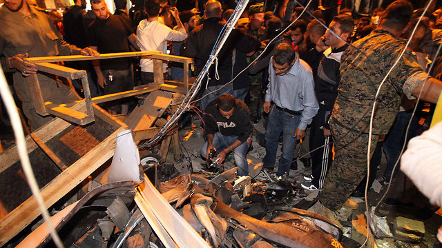 Crowds gathered at the scene of the attack surveying the destruction. (Photo: AFP)